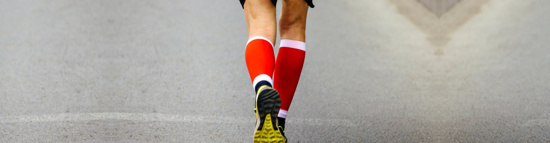 man running with his compressed socks